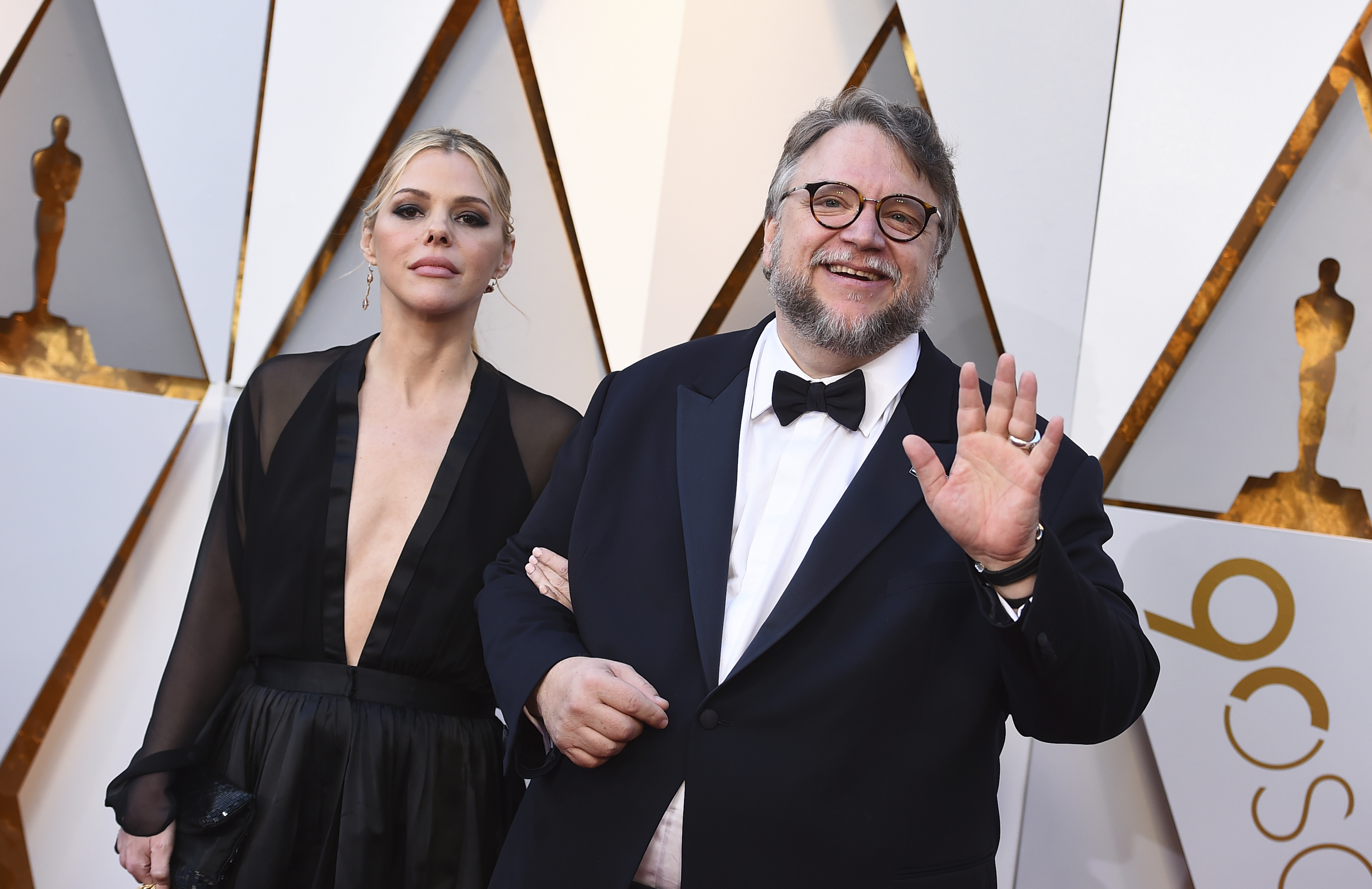 <div class='meta'><div class='origin-logo' data-origin='none'></div><span class='caption-text' data-credit='Jordan Strauss/Invision/AP'>Kim Morgan, left, and Guillermo del Toro (nominated for Best Director for ''The Shape of Water'') arrive at the Oscars.</span></div>