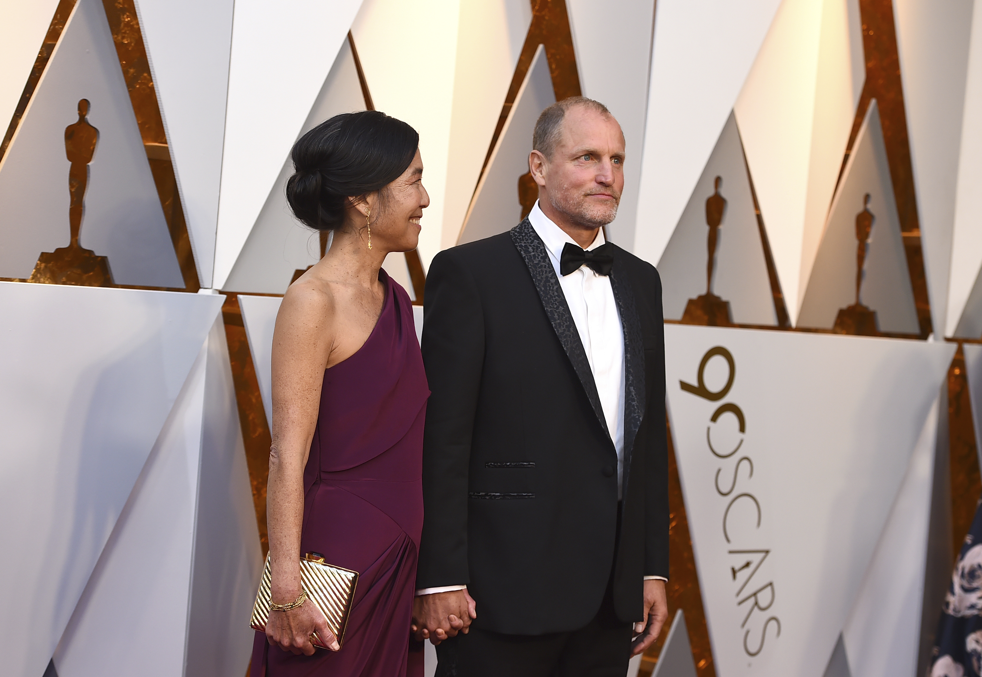 <div class='meta'><div class='origin-logo' data-origin='none'></div><span class='caption-text' data-credit='Jordan Strauss/Invision/AP'>Laura Louie, left, and Woody Harrelson (nominated for Best Supporting Actor for ''Three Billboards Outside Ebbing, Missouri'') arrive at the Oscars.</span></div>