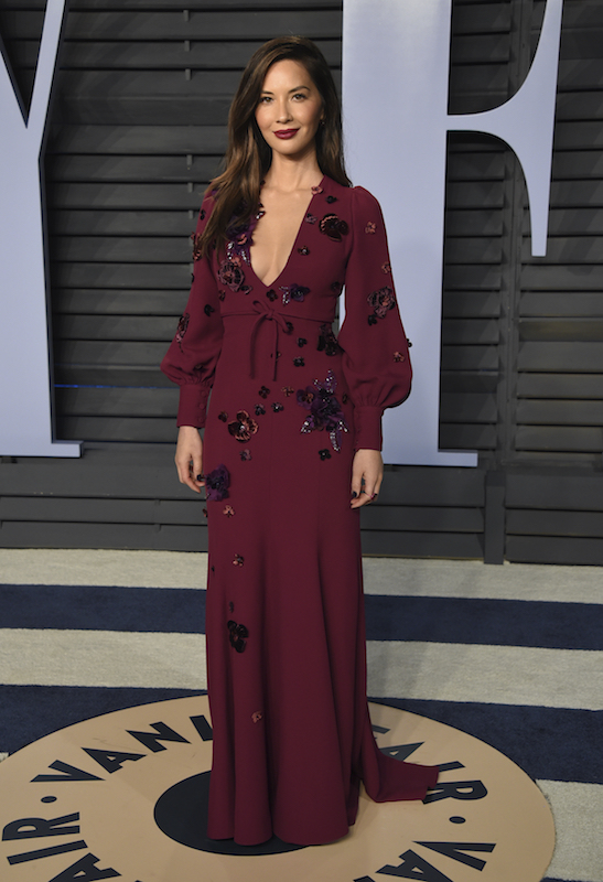 """<div class=""""meta image-caption""""><div class=""""origin-logo origin-image ap""""><span>AP</span></div><span class=""""caption-text"""">Olivia Munn arrives at the Vanity Fair Oscar Party on Sunday, March 4, 2018, in Beverly Hills, Calif. (Evan Agostini/Invision/AP)</span></div>"""