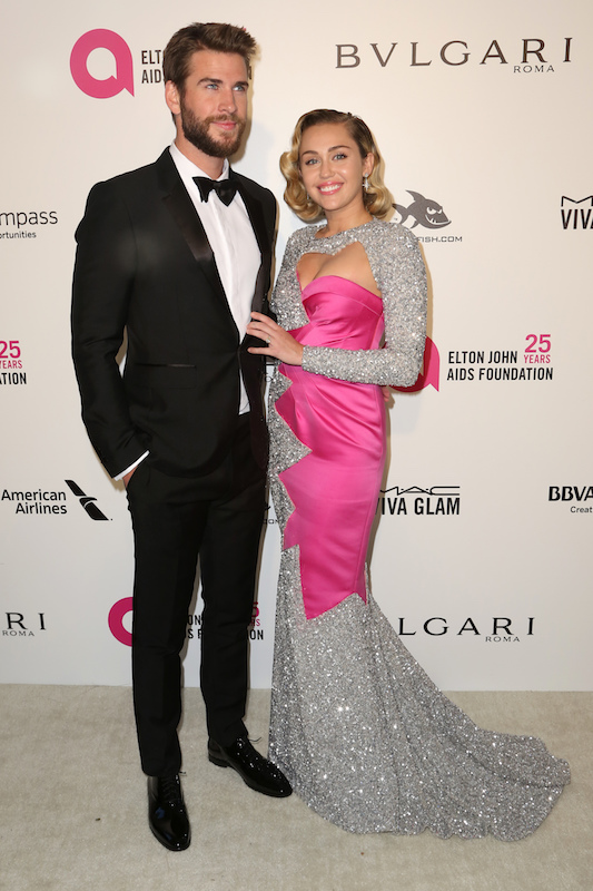 "<div class=""meta image-caption""><div class=""origin-logo origin-image ap""><span>AP</span></div><span class=""caption-text"">Liam Hemsworth, left, and Miley Cyrus arrive at the 2018 Elton John AIDS Foundation Oscar Viewing Party on Sunday, March 4, 2018, in West Hollywood, Calif. (Willy Sanjuan/Invision/AP)</span></div>"
