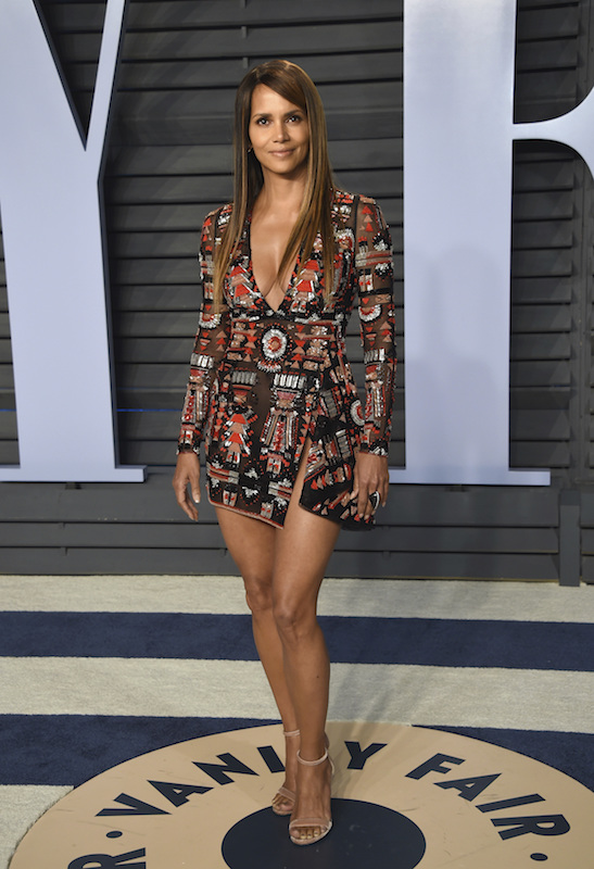 """<div class=""""meta image-caption""""><div class=""""origin-logo origin-image ap""""><span>AP</span></div><span class=""""caption-text"""">Halle Berry arrives at the Vanity Fair Oscar Party on Sunday, March 4, 2018, in Beverly Hills, Calif. (Evan Agostini/Invision/AP)</span></div>"""