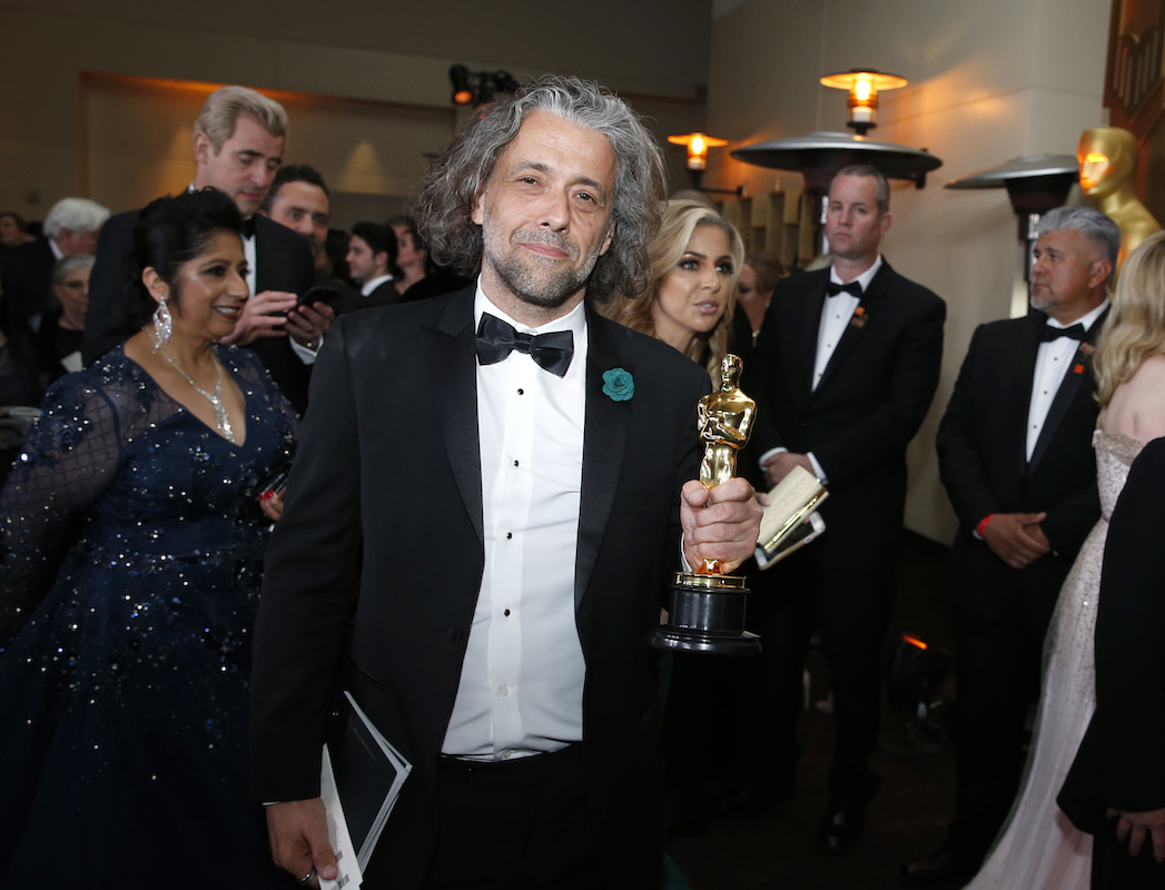 """<div class=""""meta image-caption""""><div class=""""origin-logo origin-image ap""""><span>AP</span></div><span class=""""caption-text"""">Paul Lambert, winner of the award for best visual effects for """"Blade Runner 2049"""", attends the Governors Ball after the Oscars on Sunday, March 4, 2018. (Eric Jamison/Invision/AP)</span></div>"""