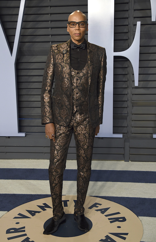 """<div class=""""meta image-caption""""><div class=""""origin-logo origin-image ap""""><span>AP</span></div><span class=""""caption-text"""">RuPaul arrives at the Vanity Fair Oscar Party on Sunday, March 4, 2018, in Beverly Hills, Calif. (Evan Agostini/Invision/AP)</span></div>"""