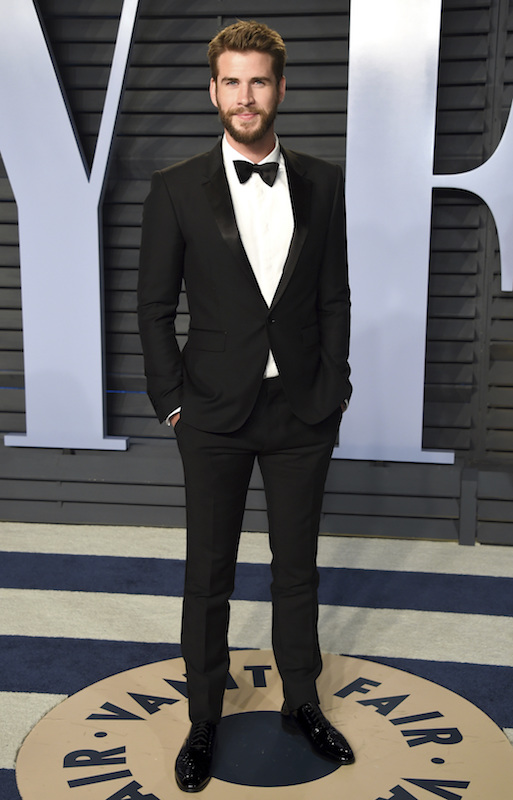 "<div class=""meta image-caption""><div class=""origin-logo origin-image ap""><span>AP</span></div><span class=""caption-text"">Liam Hemsworth arrives at the Vanity Fair Oscar Party on Sunday, March 4, 2018, in Beverly Hills, Calif. (Evan Agostini/Invision/AP)</span></div>"
