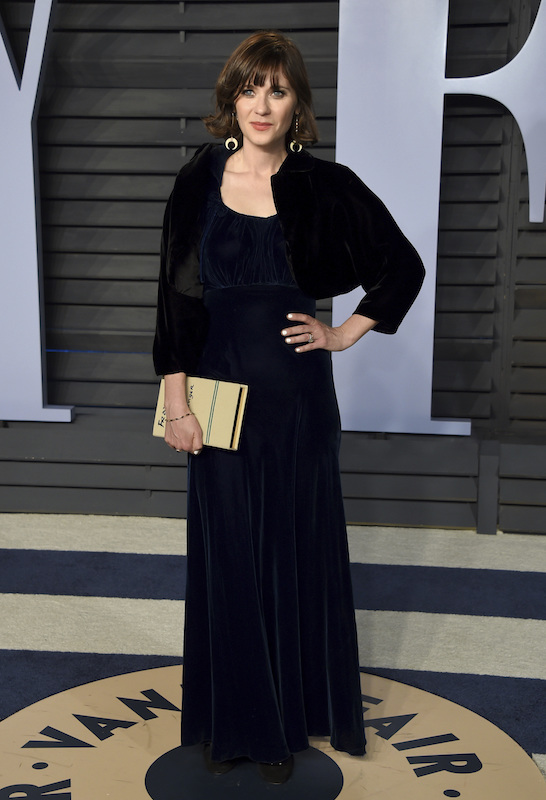 """<div class=""""meta image-caption""""><div class=""""origin-logo origin-image ap""""><span>AP</span></div><span class=""""caption-text"""">Zooey Deschanel arrives at the Vanity Fair Oscar Party on Sunday, March 4, 2018, in Beverly Hills, Calif. (Evan Agostini/Invision/AP)</span></div>"""