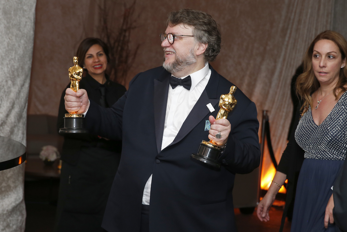 "<div class=""meta image-caption""><div class=""origin-logo origin-image ap""><span>AP</span></div><span class=""caption-text"">Guillermo del Toro poses with his awards for best director and best picture for ""The Shape of Water"" at the Governors Ball after the Oscars on Sunday, March 4, 2018. (Eric Jamison/Invision/AP)</span></div>"