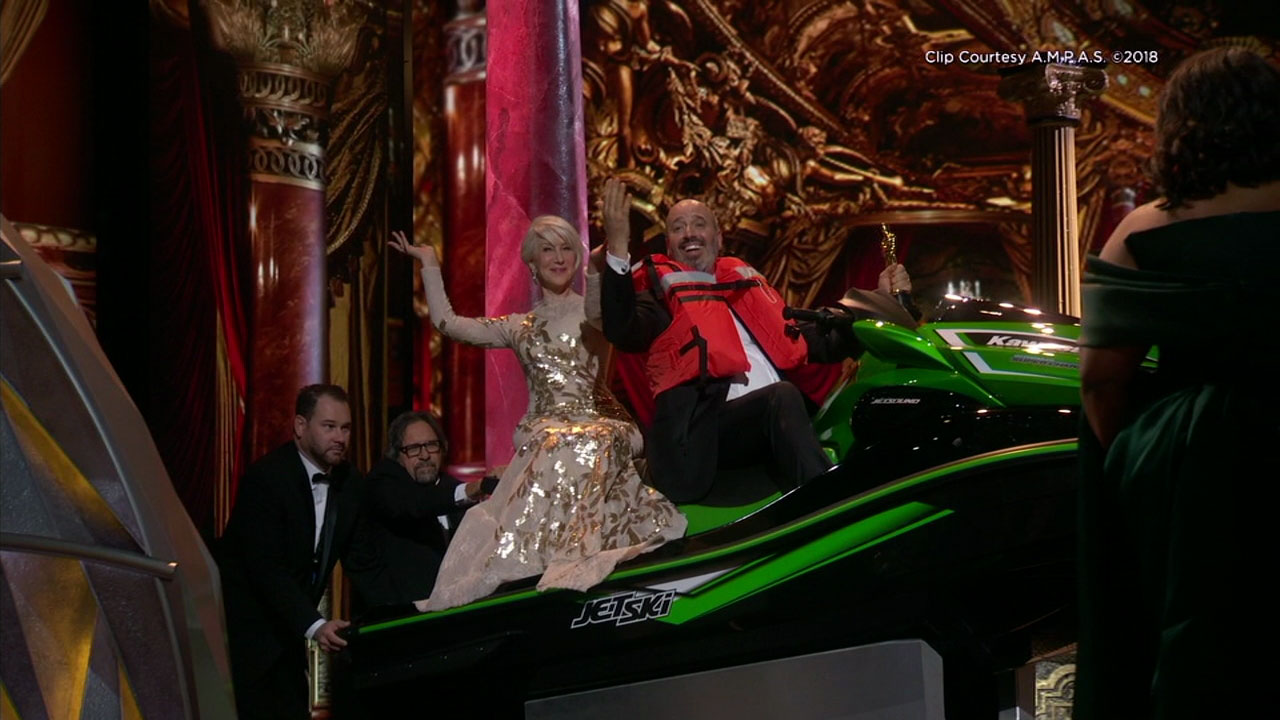 Costume designer Mark Bridges and Helen Mirren rode on a Jet Ski that Bridges won for delivering the shortest Oscar acceptance speech at the ceremony.