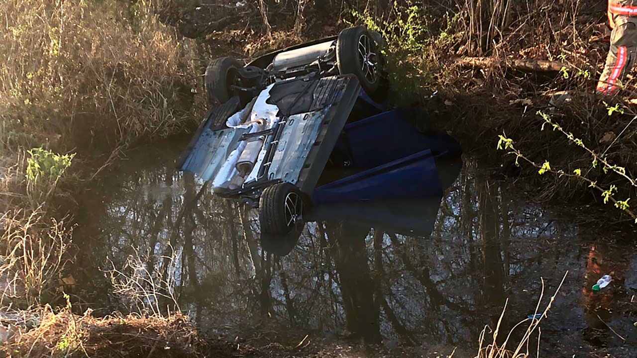 Jarrell Booker was trapped in the car after he fell asleep at the wheel and crashed Monday morning.
