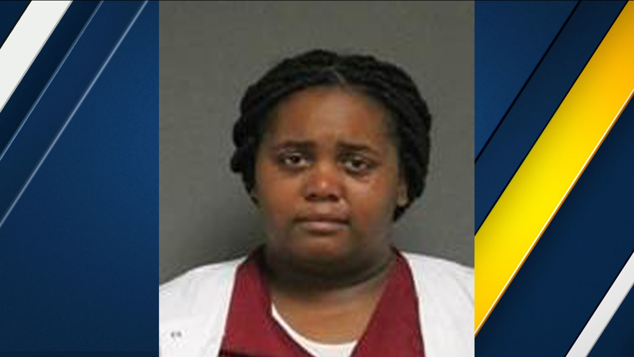 Aujana Johnson-Payne is shown in a mugshot provided by Tustin police.