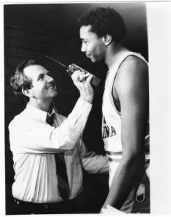 <div class='meta'><div class='origin-logo' data-origin='none'></div><span class='caption-text' data-credit='Credit: Hugh Morton Collection of Photographs and Films via UNC'>UNC sports announcer Woody Durham interviewing UNC basketball player Warren Martin.</span></div>