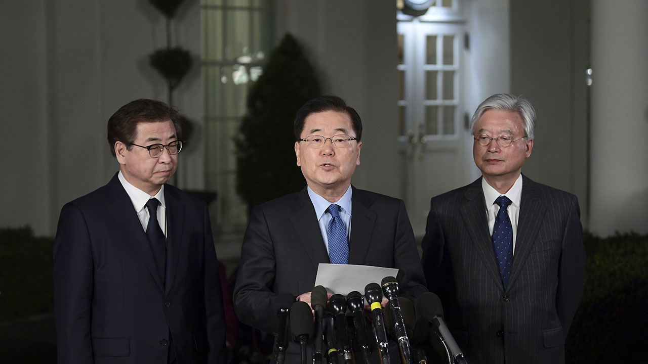 South Korean national security director Chung Eui-yong, center, speaks to reporters at the White House on Thursday. Intelligence chief Suh Hoon is at left.
