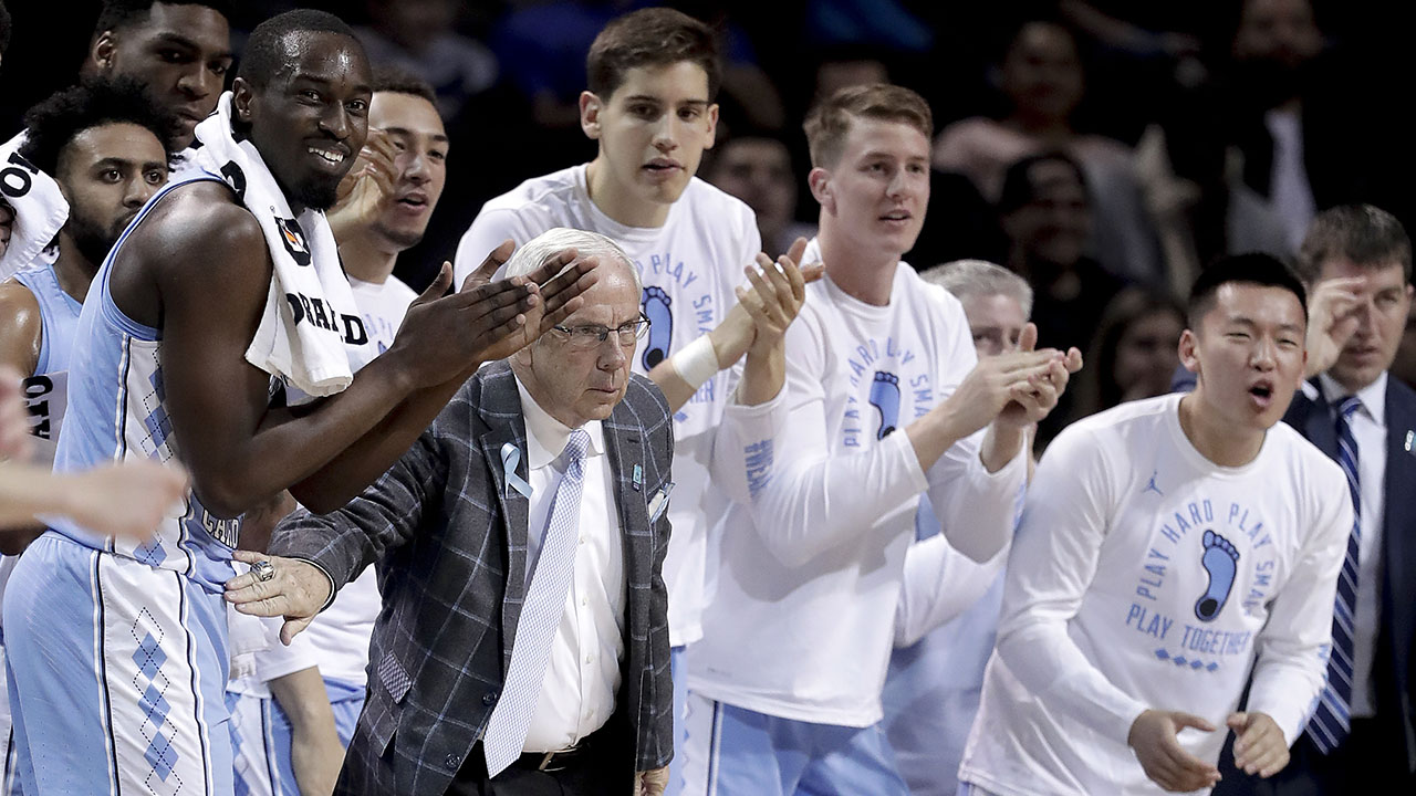 North Carolina head coach Roy Williams and players react against Miami on Thursday in the ACC Tournament.