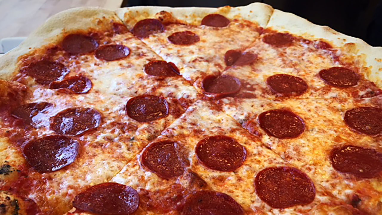 The Pizza Times serves up to-go slices until midnight.