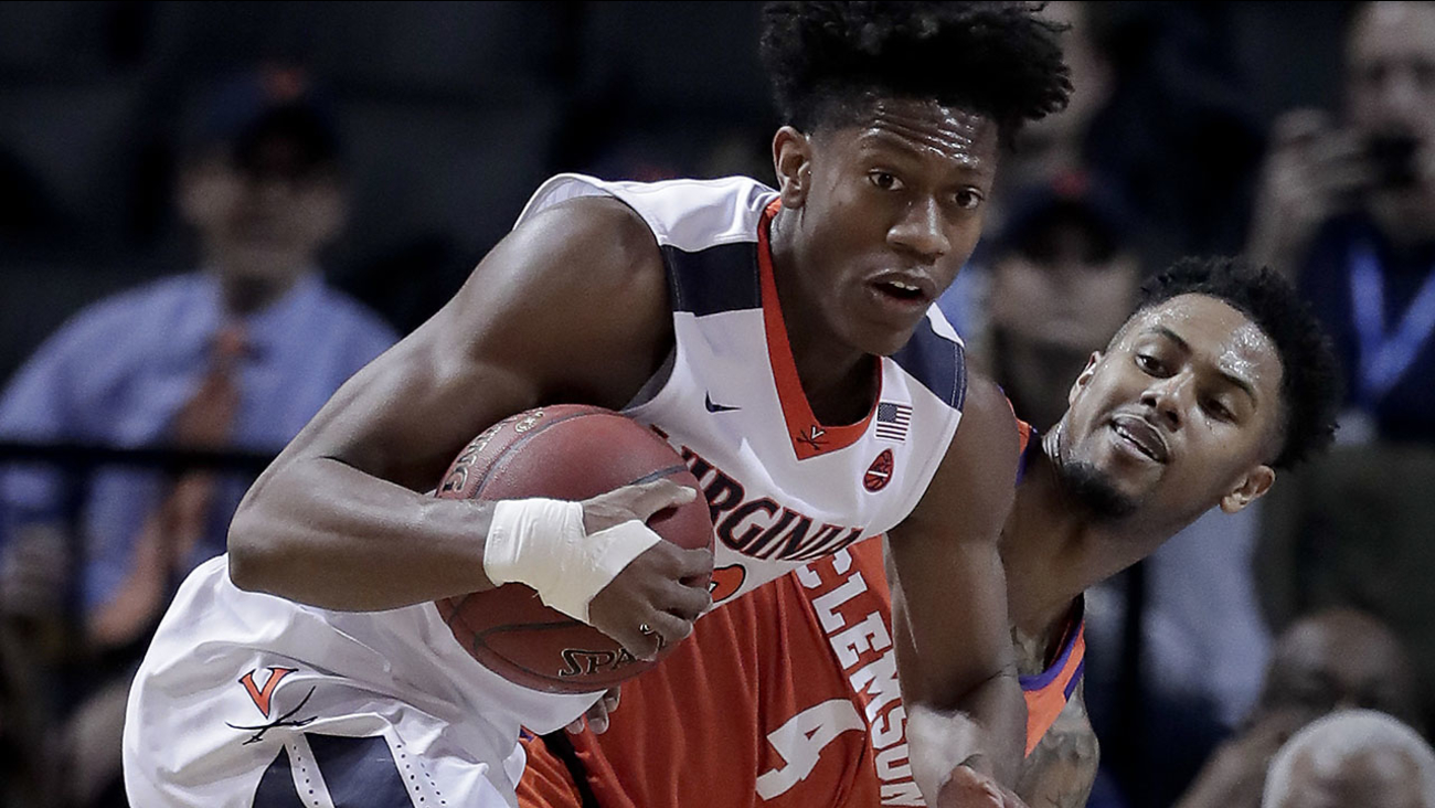 Virginia guard De'Andre Hunter (12) pulls down a rebound next to Clemson guard Shelton Mitchell in the ACC Tournament semifinals Friday.