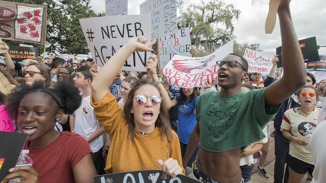 Therese Gachnauer from Chiles High School and Kwane Gatlin from Lincoln High School, both in Tallahassee, join fellow students protesting gun violence in Tallahassee, Fla.,Feb. 21, 2018.