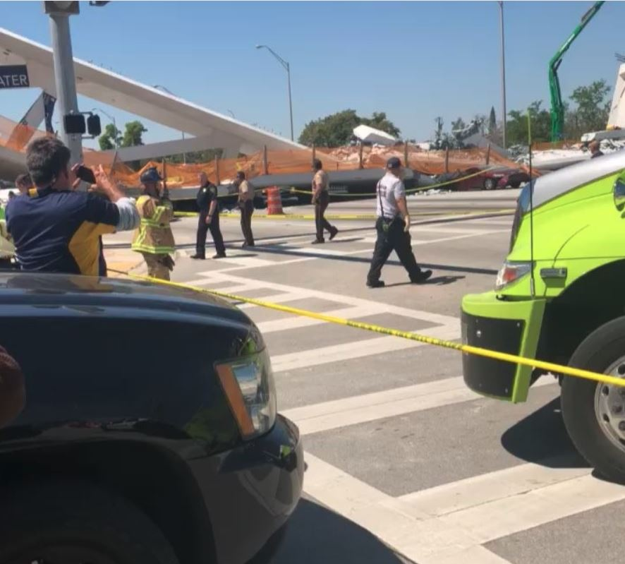 <div class='meta'><div class='origin-logo' data-origin='none'></div><span class='caption-text' data-credit='@_xaboveaveragex_ / Instagram'>Moments after a pedestrian bridge collapsed on the Florida International University campus Thursday.</span></div>