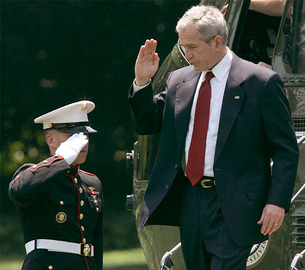 "<div class=""meta image-caption""><div class=""origin-logo origin-image ""><span></span></div><span class=""caption-text"">President Bush salutes while stepping off of Marine One in July 2008. (Susan Walsh / AP)</span></div>"