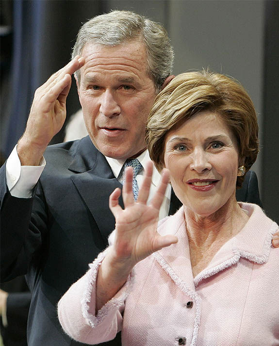 "<div class=""meta image-caption""><div class=""origin-logo origin-image ""><span></span></div><span class=""caption-text"">President Bush and First Lady Laura Bush wave during a election victory rally in November 2004. (Lionel Cironneau / AP)</span></div>"
