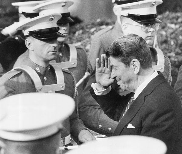 "<div class=""meta image-caption""><div class=""origin-logo origin-image ""><span></span></div><span class=""caption-text"">President Reagan saluting members of the U.S. Marine Band in November 1986. (Ron Edmonds / AP)</span></div>"