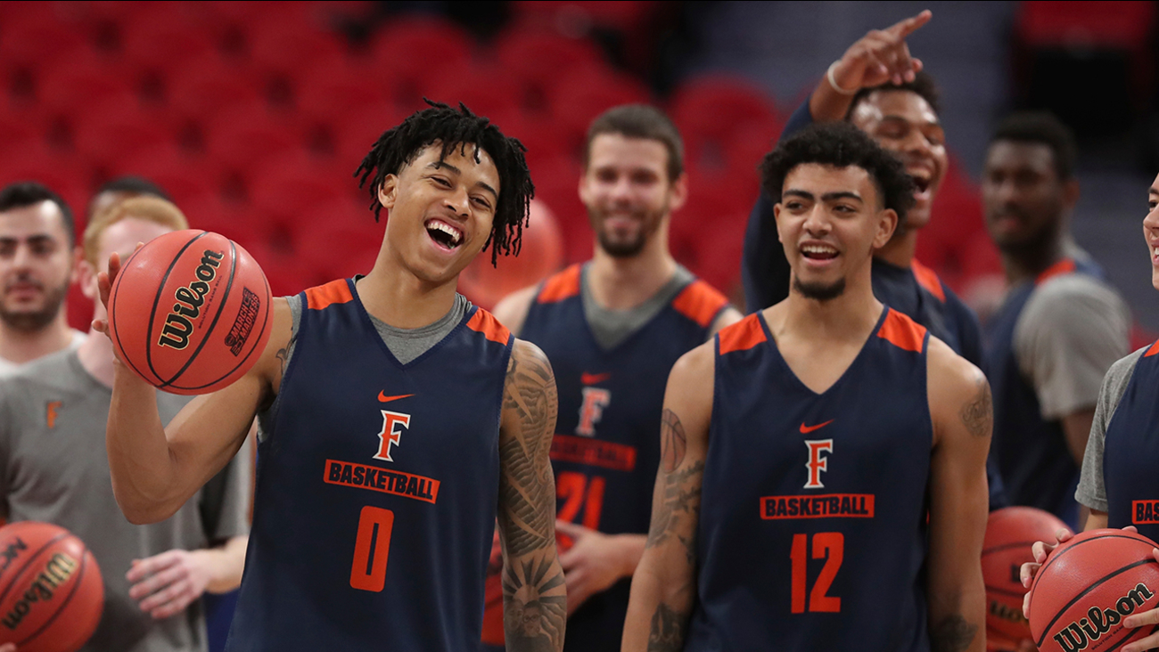 Cal State Fullerton Titans guards wait to shoot from mid-court during a practice for an NCAA men's basketball tournament first-round game, Thursday, March 15, 2018, in Detroit.