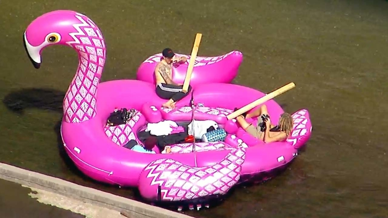 Group floats down LA River in inflatable pink flamingo raft