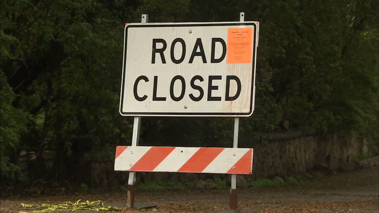 A road closure sign is shown in areas of the Thomas Fire burn area during rainstorms that hit the region in January 2018.