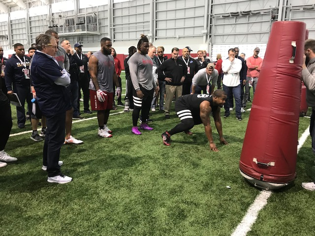 <div class='meta'><div class='origin-logo' data-origin='WTVD'></div><span class='caption-text' data-credit='Charlie Mickens'>Patriots coach Bill Belichick and others watch defensive line drills at NC State's pro day.</span></div>
