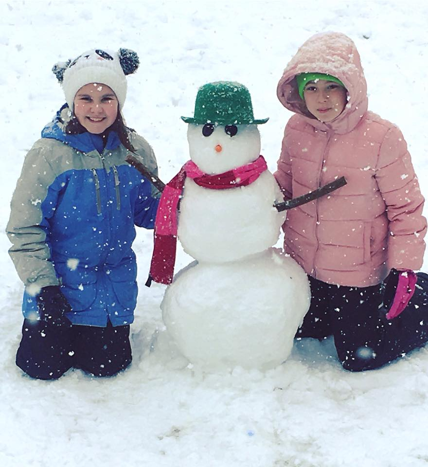"""<div class=""""meta image-caption""""><div class=""""origin-logo origin-image none""""><span>none</span></div><span class=""""caption-text"""">Two young girls pose with their fashionable snowman. (Danielle E Kertis)</span></div>"""
