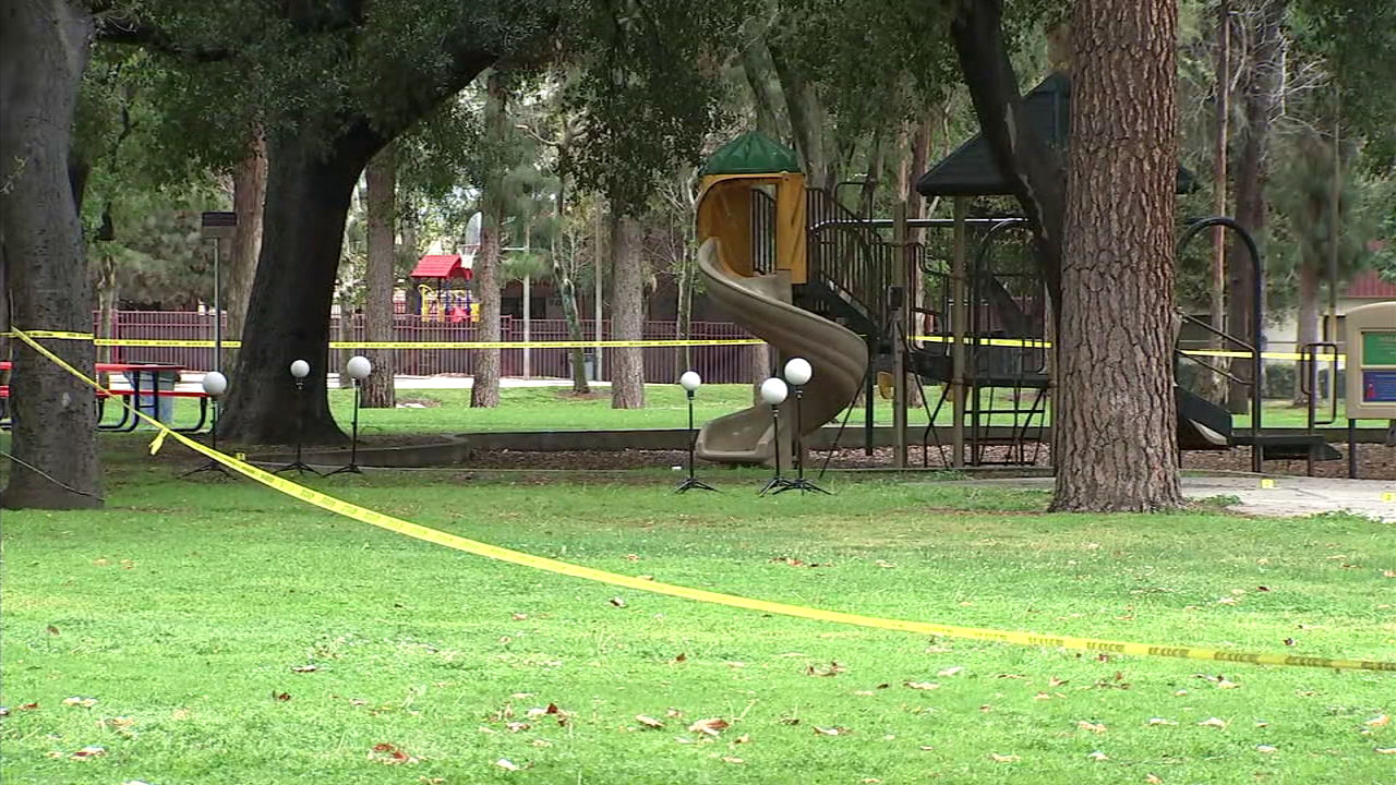 Crime tape surrounds a bloody scene at an Upland park on Wednesday, March 21, 2018. Police are investigating whether the scene is connected to a man's death at a nearby apartment.