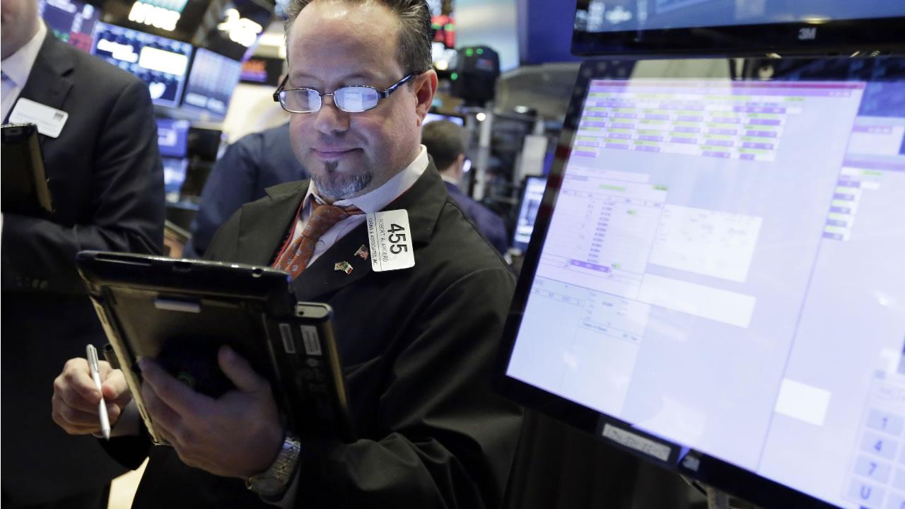 Trader Robert Arciero works on the floor of the New York Stock Exchange, Friday, Feb. 9, 2018. (AP Photo/Richard Drew)