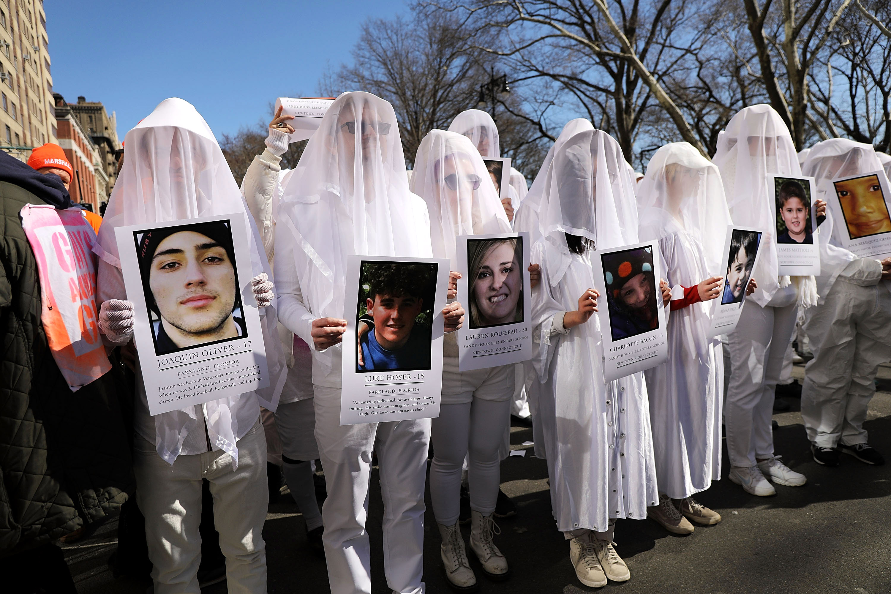 <div class='meta'><div class='origin-logo' data-origin='none'></div><span class='caption-text' data-credit='Getty Spencer Platt/Getty Images'>Holding pictures of victims killed in gun violence, thousands of people, many of them students, march against gun violence in Manhattan.</span></div>
