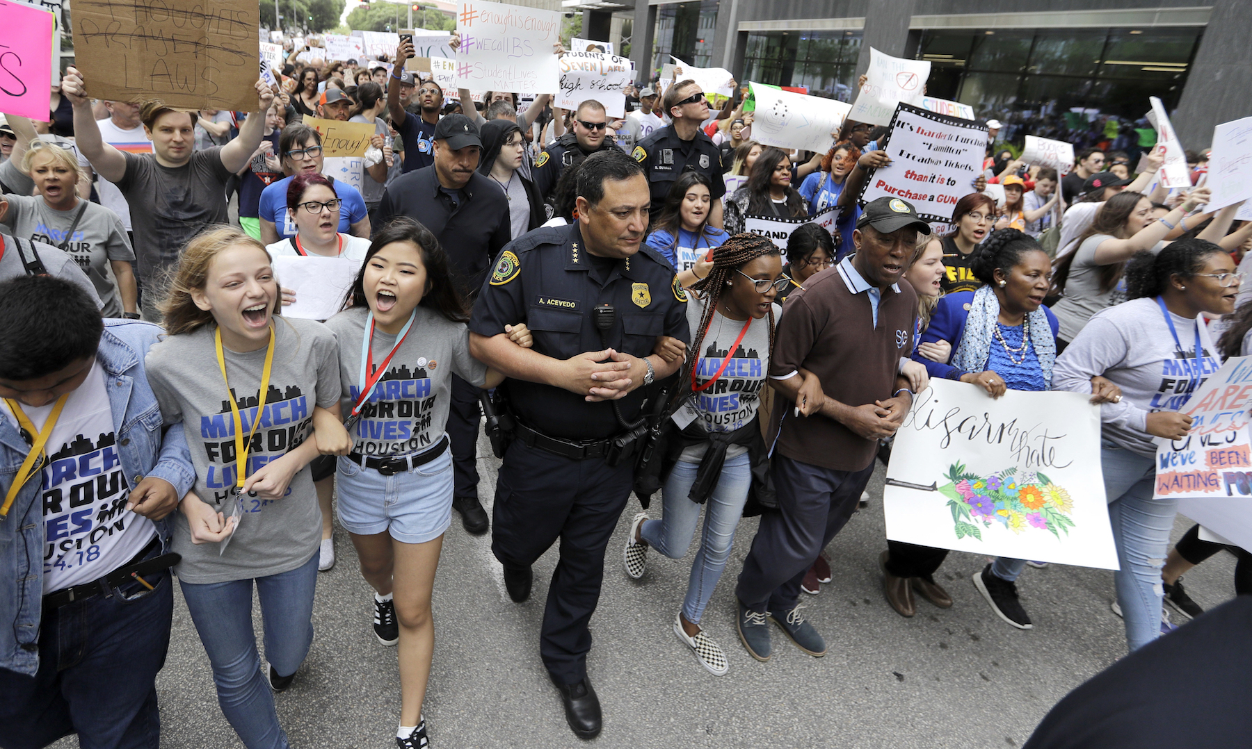 "<div class=""meta image-caption""><div class=""origin-logo origin-image ap""><span>AP</span></div><span class=""caption-text"">Houston Police Chief Art Acevedo, Houston Mayor Sylvester Turner, and Rep. Sheila Jackson Lee, D-Texas, join demonstrators during a March for Our Lives protest in Houston. (AP Photo/David J. Phillip)</span></div>"