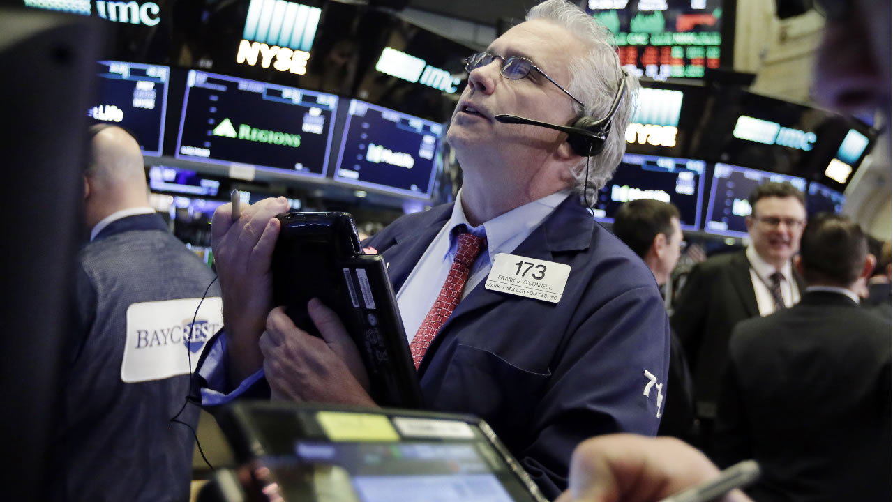 Trader Fran O'Connell works on the floor of the New York Stock Exchange, Monday, March 26, 2018. (AP Photo/Richard Drew)