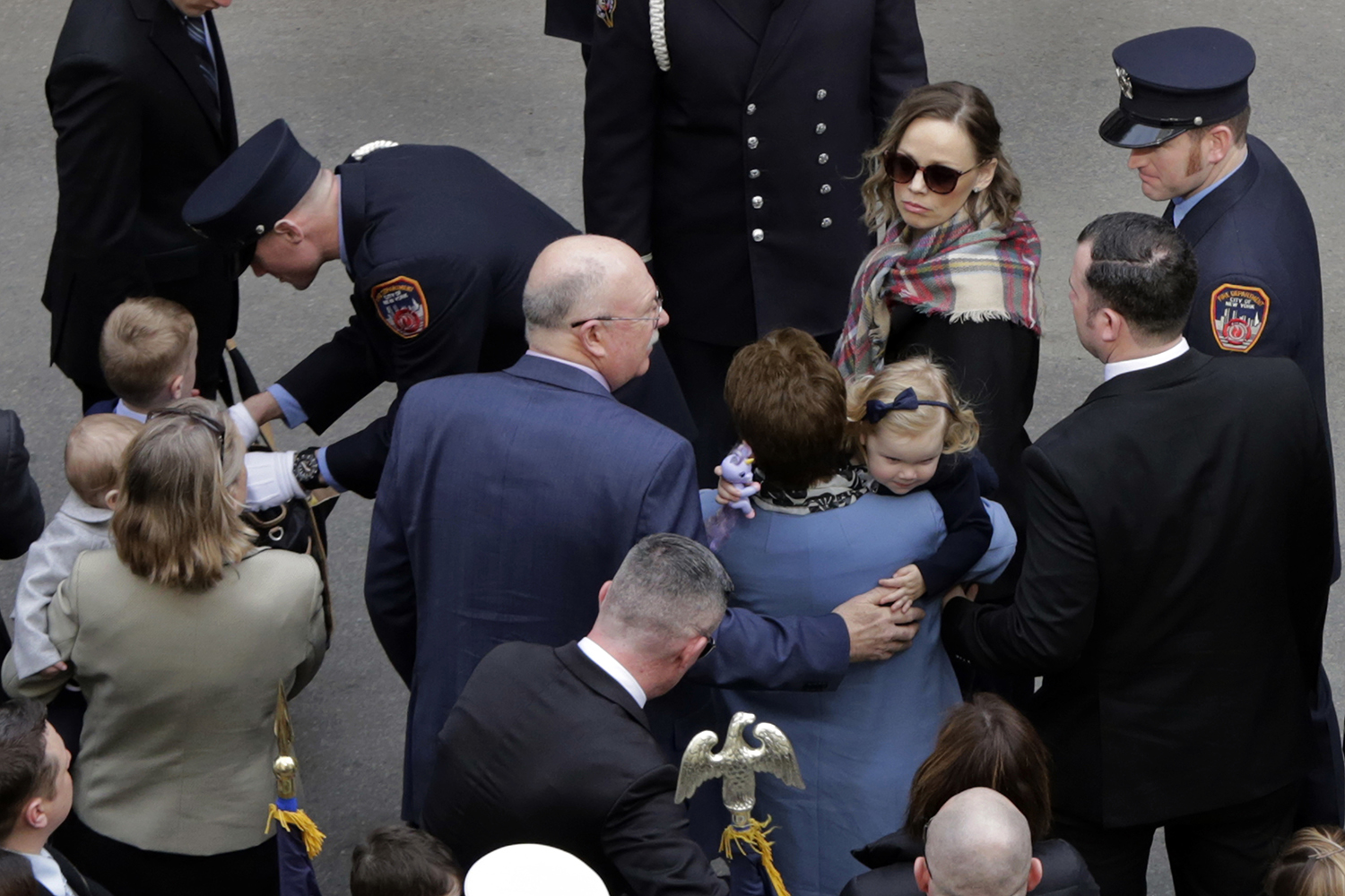 <div class='meta'><div class='origin-logo' data-origin='AP'></div><span class='caption-text' data-credit='Richard Drew'>Eileen Davidson, right, widow of firefighter Michael Davidson arrives for the funeral of her husband at New York's St. Patrick's Cathedral.</span></div>
