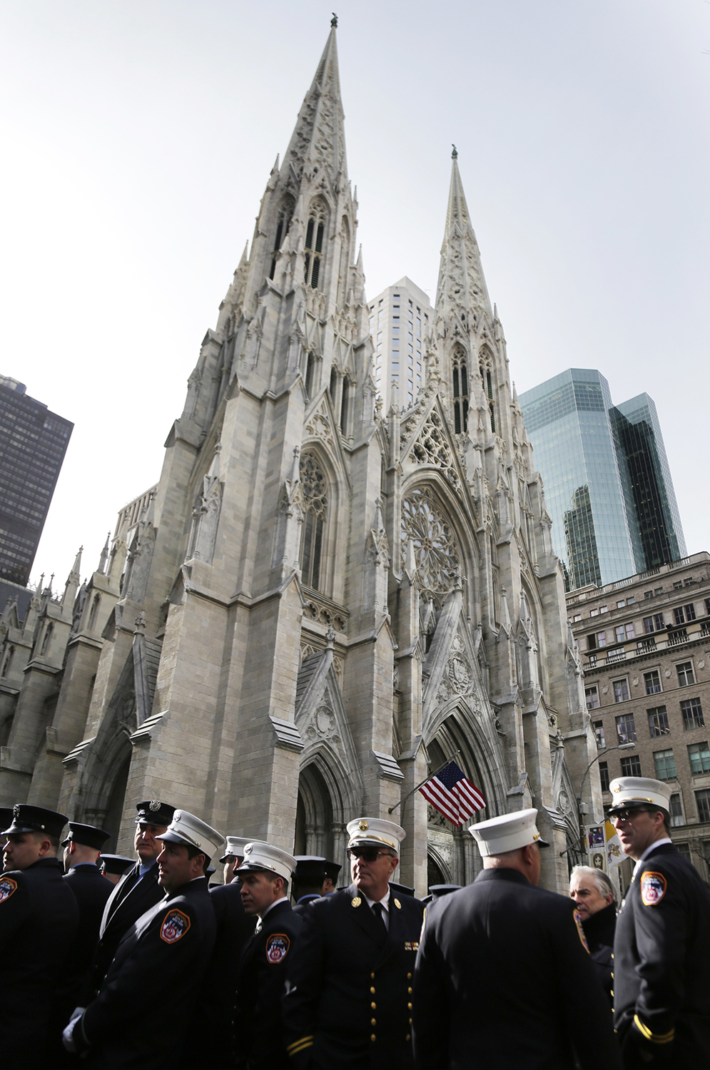 <div class='meta'><div class='origin-logo' data-origin='AP'></div><span class='caption-text' data-credit='Seth Wenig'>Firefighters stand outside St. Patrick's Cathedral as they wait for the start of the funeral of firefighter Michael Davidson.</span></div>