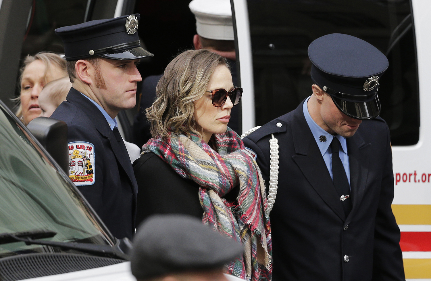<div class='meta'><div class='origin-logo' data-origin='AP'></div><span class='caption-text' data-credit='Seth Wenig'>Eileen Davidson, wife of firefighter Michael Davidson, stands outside St. Patrick's Cathedral after arriving for his funeral.</span></div>
