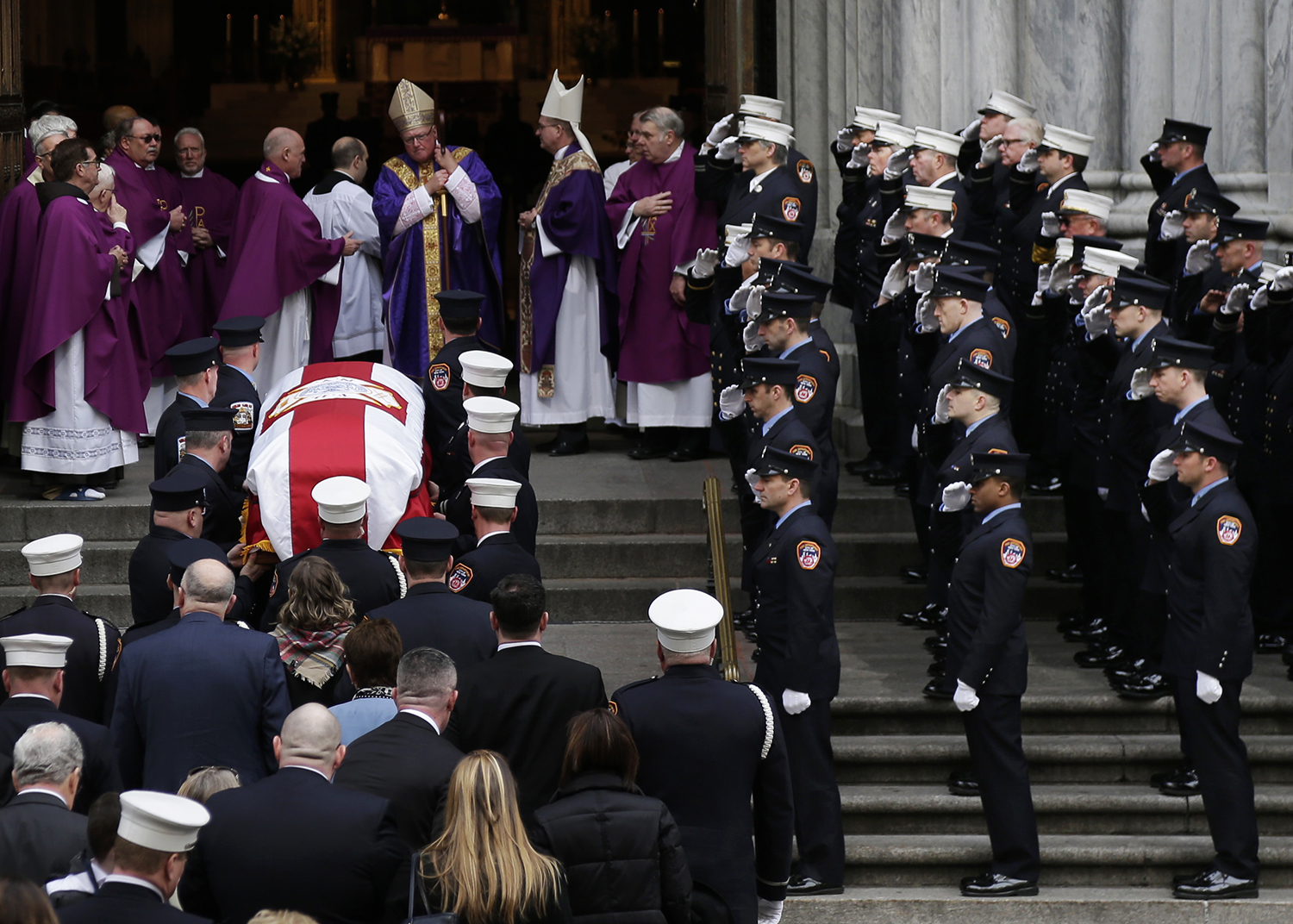 <div class='meta'><div class='origin-logo' data-origin='AP'></div><span class='caption-text' data-credit='Seth Wenig'>A casket containing the body of firefighter Michael Davidson is brought into St. Patrick's Cathedral.</span></div>