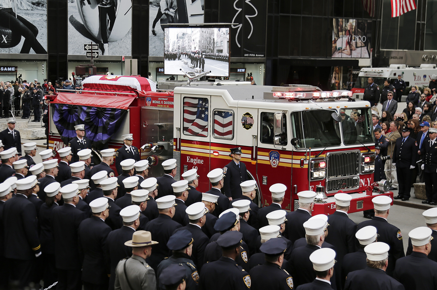 <div class='meta'><div class='origin-logo' data-origin='AP'></div><span class='caption-text' data-credit='Seth Wenig'>The body of firefighter Michael Davidson is brought to St. Patrick's Cathedral on a firetruck.</span></div>