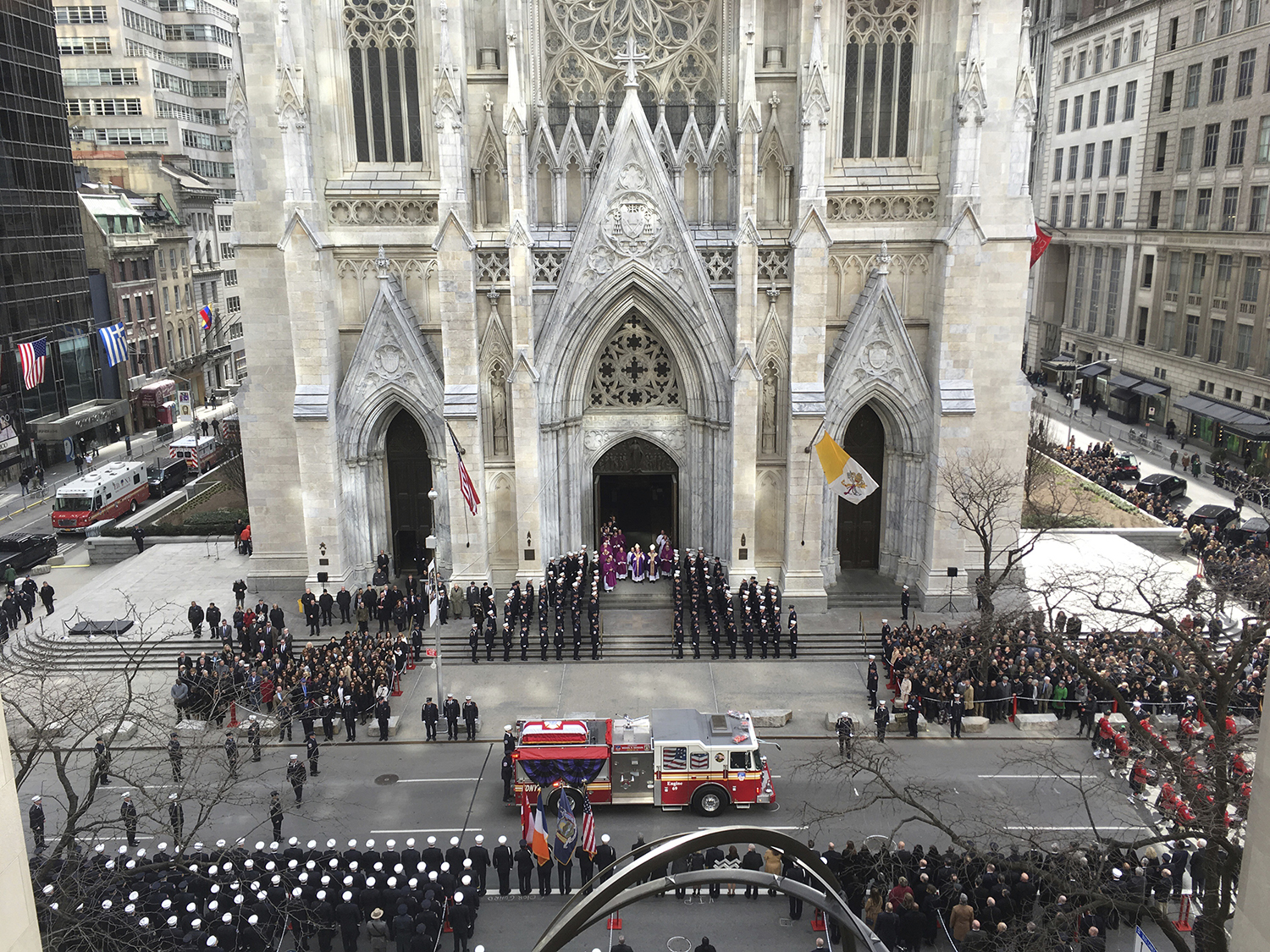 <div class='meta'><div class='origin-logo' data-origin='AP'></div><span class='caption-text' data-credit='Richard Drew'>A firetruck arrives at New York's St. Patrick's Cathedral bearing the body of Lt. Michael Davidson as mourners gathered.</span></div>