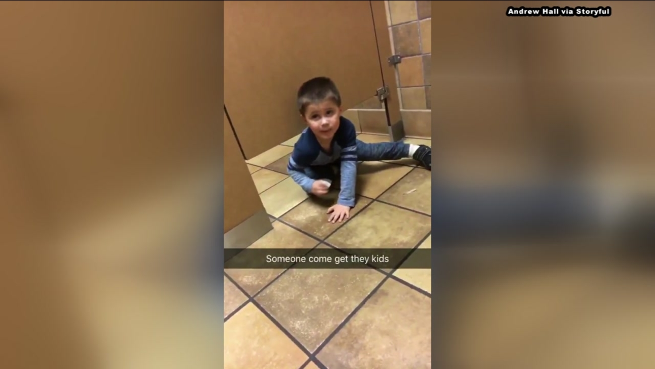 Kid crawls under bathroom stall while Chick-fil-A attempts to use bathroom