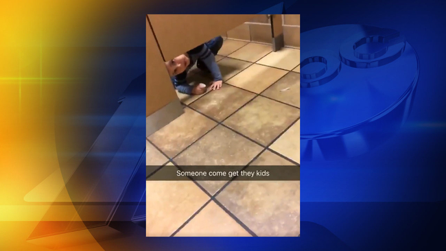 Surprise ChickfilA Customer Gets Unexpected Visit From Boy While - Boy crawls under bathroom stall