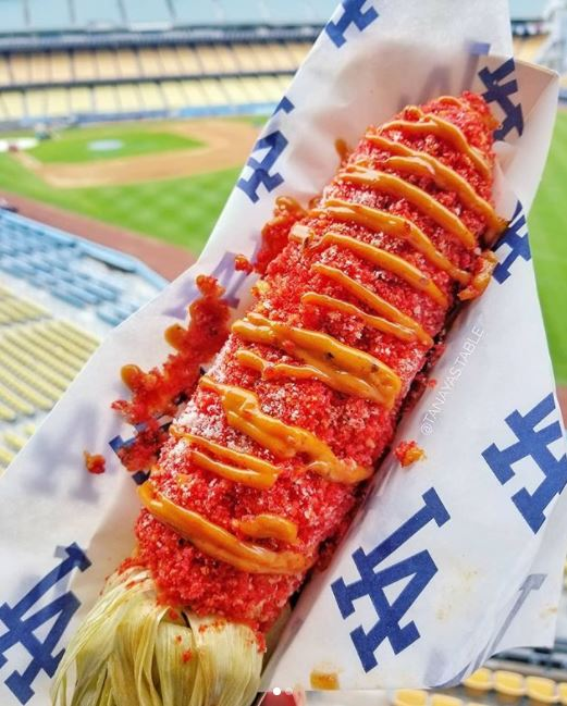 "<div class=""meta image-caption""><div class=""origin-logo origin-image none""><span>none</span></div><span class=""caption-text"">A Flamin' Hot Cheetos corn on the cob is shown at Dodger Stadium. (Twitter/@TanayasTable)</span></div>"