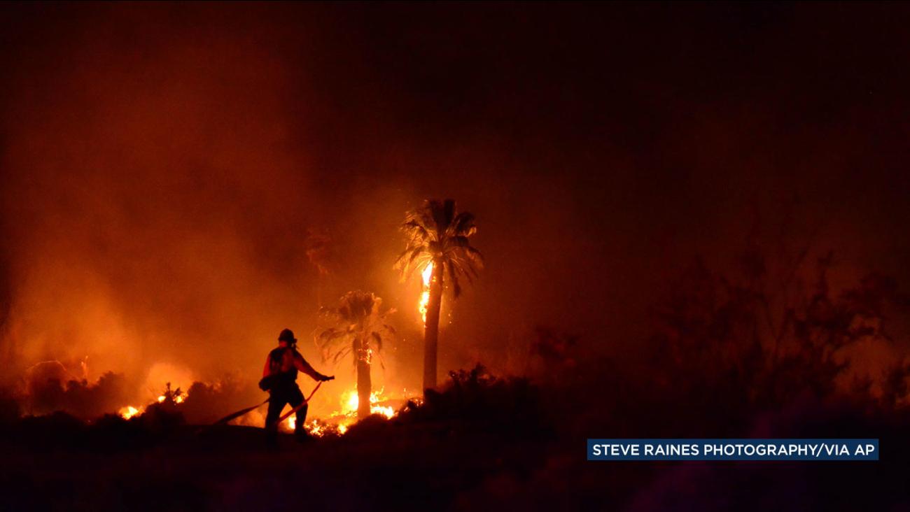 A firefighter battles a blaze at Joshua Tree National Park on Monday, March 26, 2018.