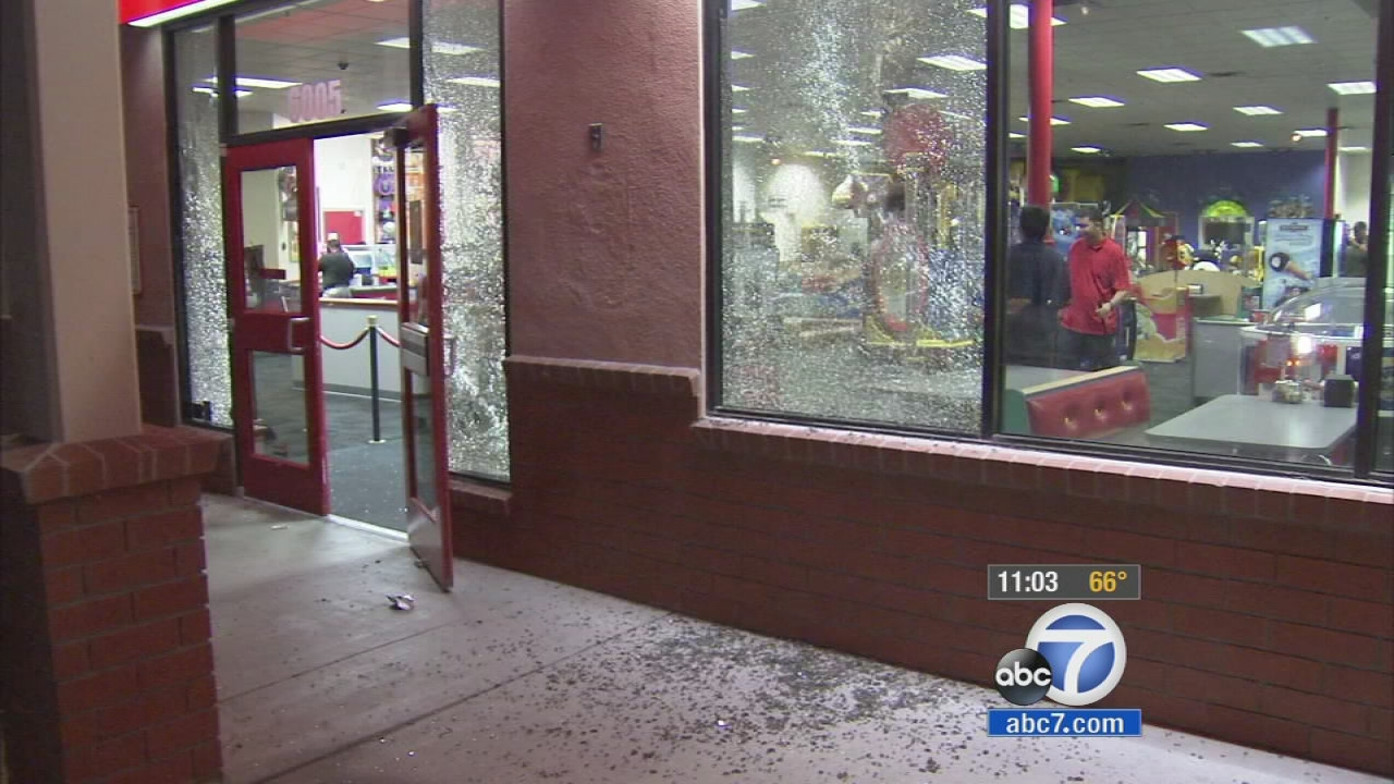 Shattered glass is seen after shots were fired at a Chuck E. Cheese in Pico Rivera on Sunday, Sept. 28, 2014.