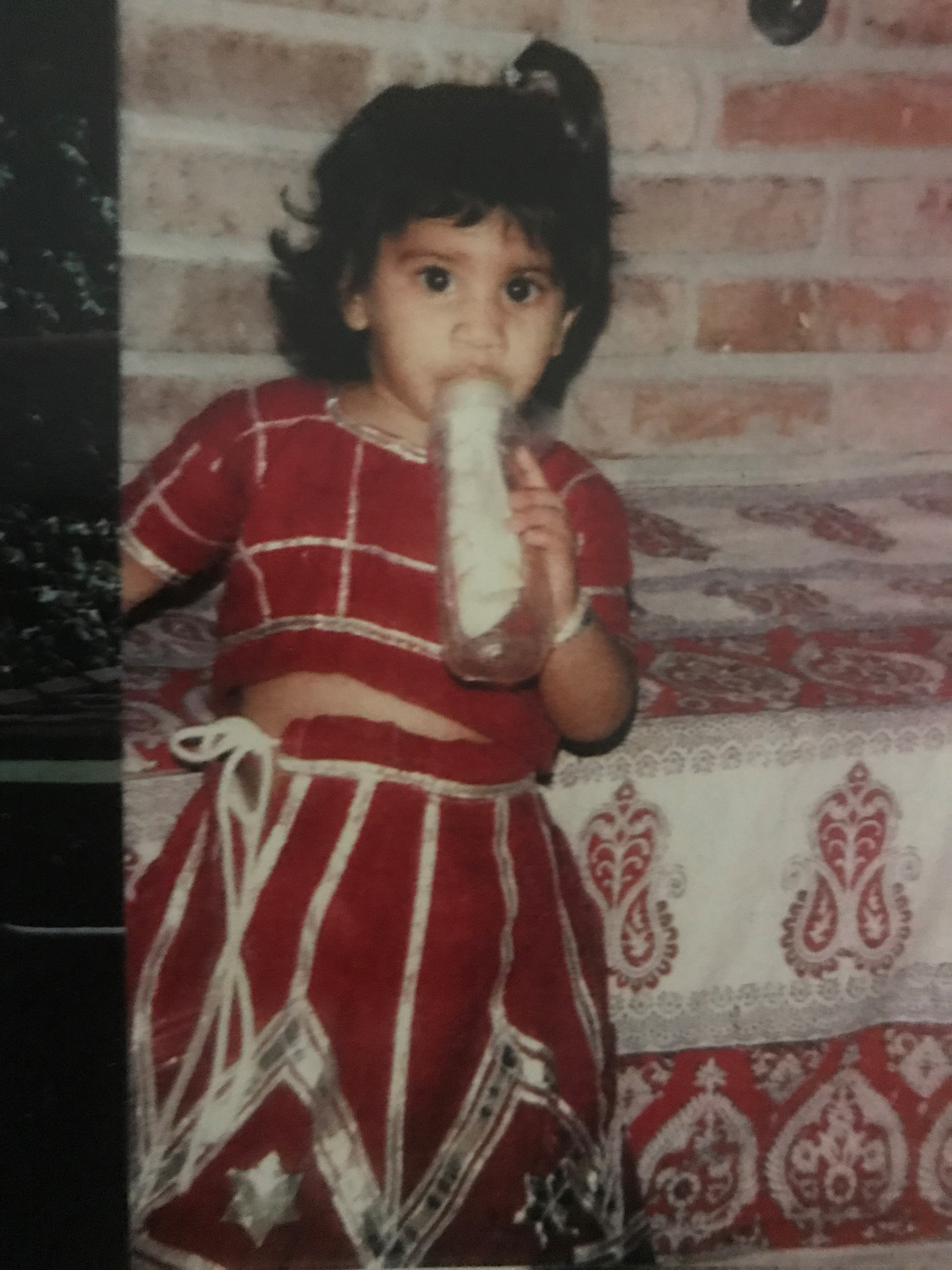 <div class='meta'><div class='origin-logo' data-origin='none'></div><span class='caption-text' data-credit=''>Pooja was always so fashionable, as documented in this photo from a trip to India as a very little girl. So cute!</span></div>