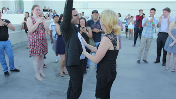 """<div class=""""meta image-caption""""><div class=""""origin-logo origin-image """"><span></span></div><span class=""""caption-text"""">''She said yes!'' The groom-to-be says after pulling off his elaborate surprise proposal. (Photo/YouTube, Omar Kenawi)</span></div>"""