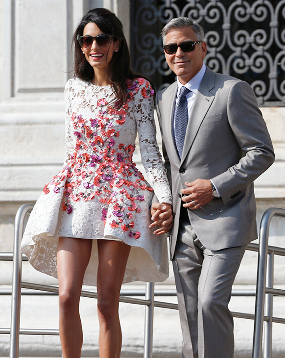 """<div class=""""meta image-caption""""><div class=""""origin-logo origin-image """"><span></span></div><span class=""""caption-text"""">George Clooney is flanked by his wife Amal Alamuddin as they leave the Aman luxury Hotel in Venice, Italy, Sunday, Sept. 28, 2014. (AP Photo/Luca Bruno)</span></div>"""