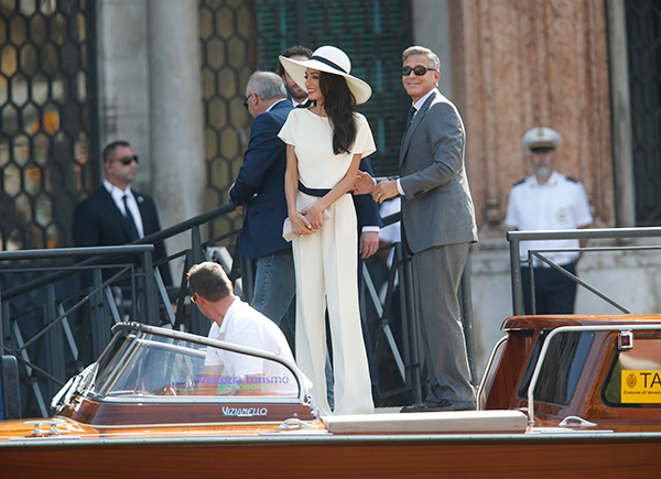 "<div class=""meta image-caption""><div class=""origin-logo origin-image ""><span></span></div><span class=""caption-text"">George Clooney, flanked by his wife Amal Alamuddin, arrives at the Cavalli Palace for their civil marriage ceremony in Venice, Italy, Monday, Sept. 29, 2014. (AP Photo/Luca Bruno)</span></div>"