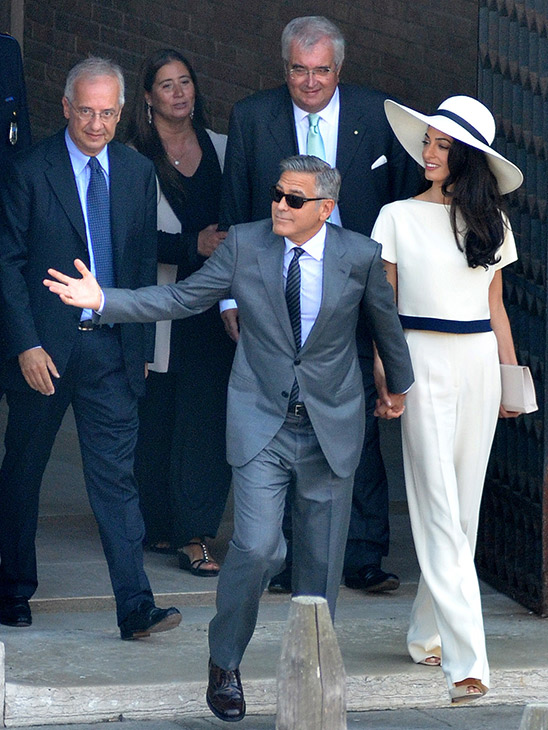 "<div class=""meta image-caption""><div class=""origin-logo origin-image ""><span></span></div><span class=""caption-text"">George Clooney and his wife Amal Alamuddin leave the city hall after their civil marriage ceremony performed by Rome's former mayor Walter Veltroni, left, in Venice, Italy. (AP Photo/Luigi Costantini)</span></div>"