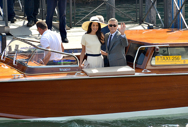 "<div class=""meta image-caption""><div class=""origin-logo origin-image ""><span></span></div><span class=""caption-text"">George Clooney, flanked by his wife Amal Alamuddin, waves from a water-taxi after leaving Venice's city hall following their civil marriage ceremony on Monday, Sept. 29, 2014. (AP Photo/Luigi Costantini)</span></div>"